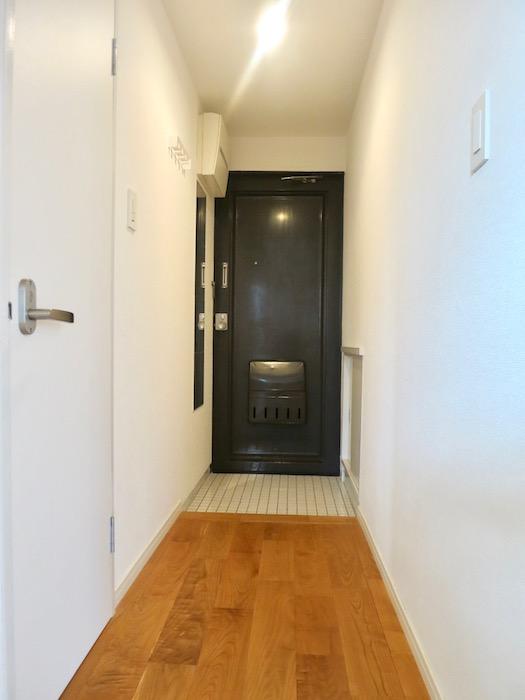 7A ナゴヤマンション今池 TOMOSのシンプルナチュラルな玄関 無垢の床2
