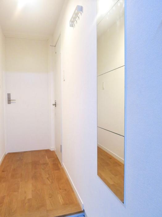 7A ナゴヤマンション今池 TOMOSのシンプルナチュラルな玄関 無垢の床1